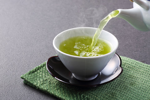 green tea being poured