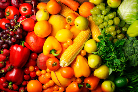 rainbow of fruit and vegetables including peppers tomatoes spinach and broccoli