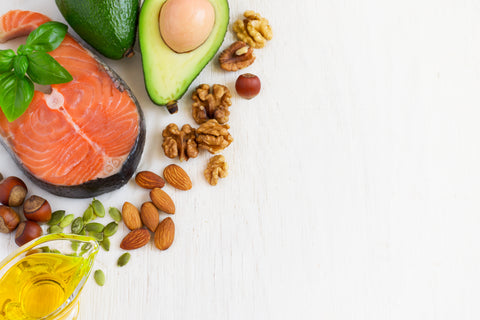 healthy fat foods, oil, salmon, almonds, and other nuts