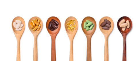 wood spoons holding pills