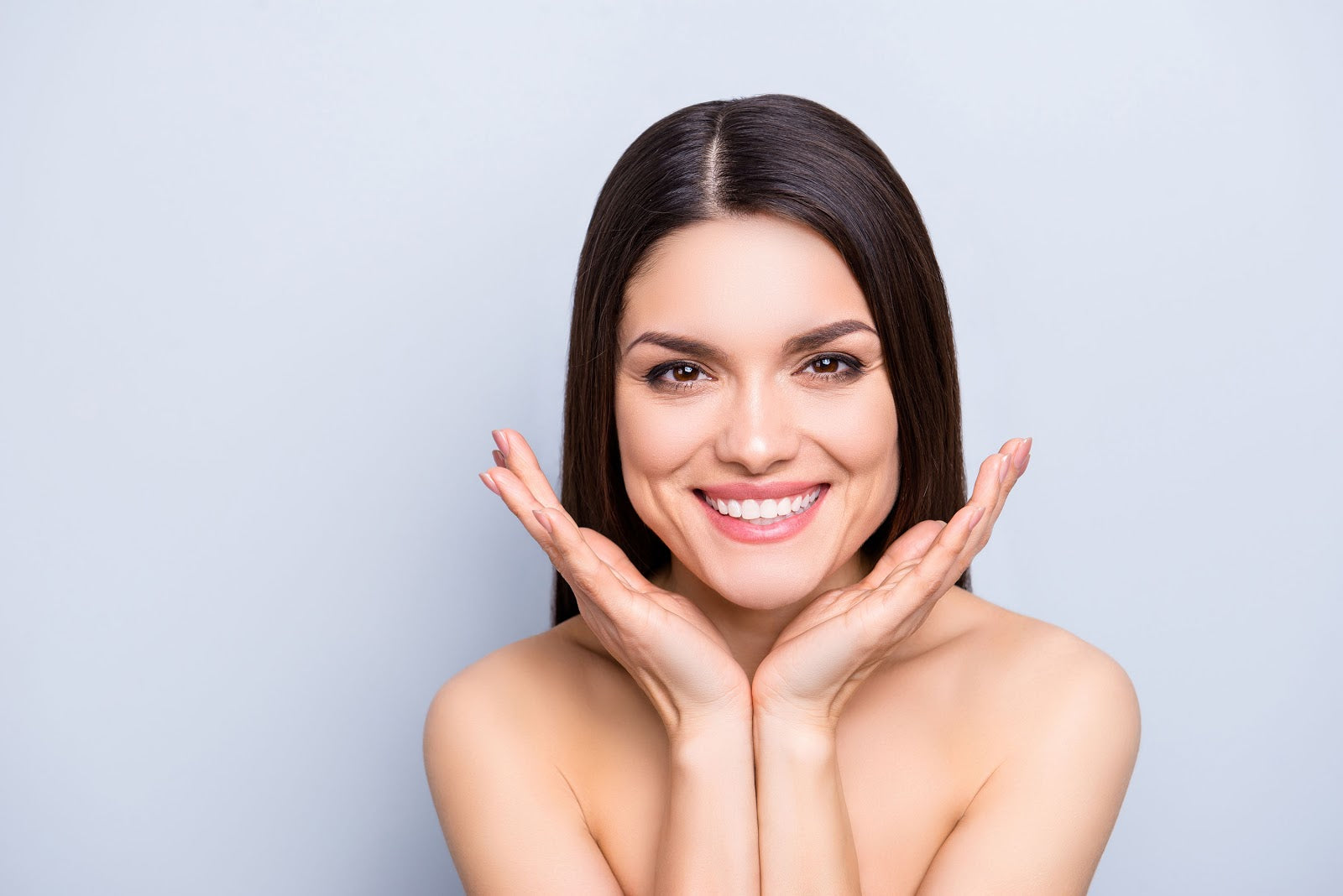 Woman smiling because she's eaten foods with collagen