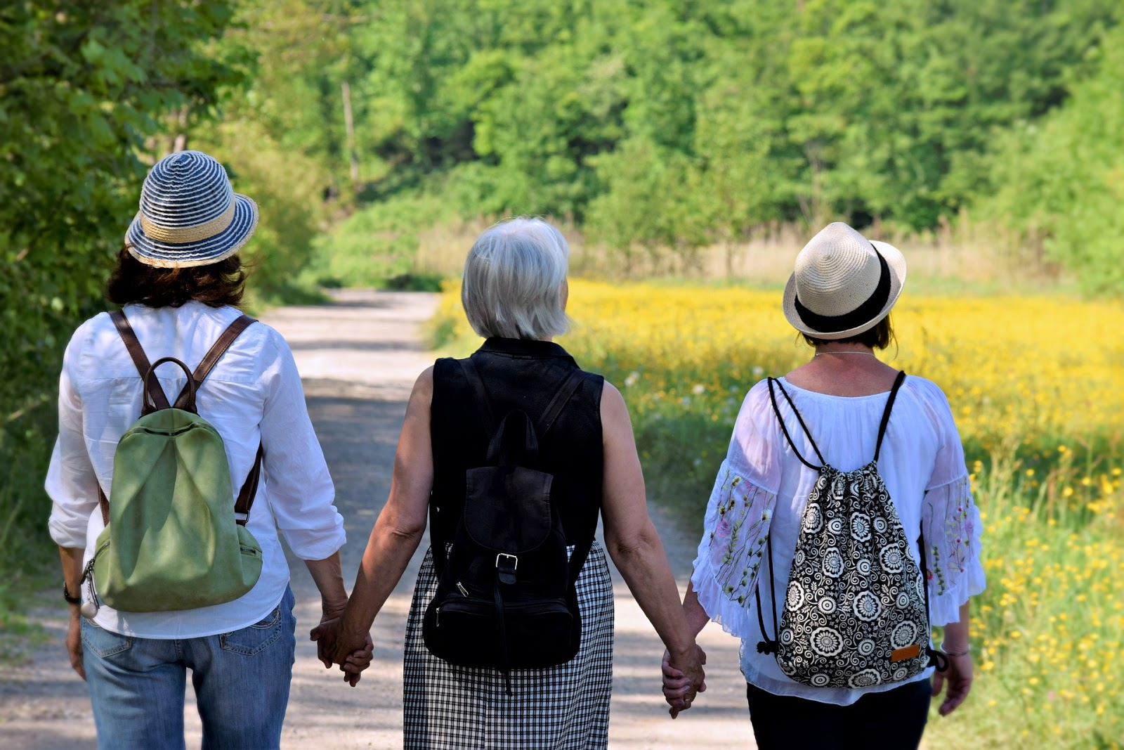 Three older women holding hands