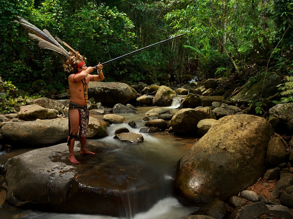 Tribesman hunting with a blowpipe