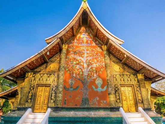A beautiful painting on the wall of Wat Xieng Thong