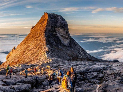 A group of tourists at the peak of Mount Kinabalu