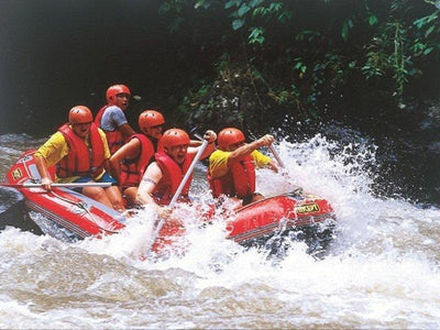 A group of tourists white water rafting in the Ayung River