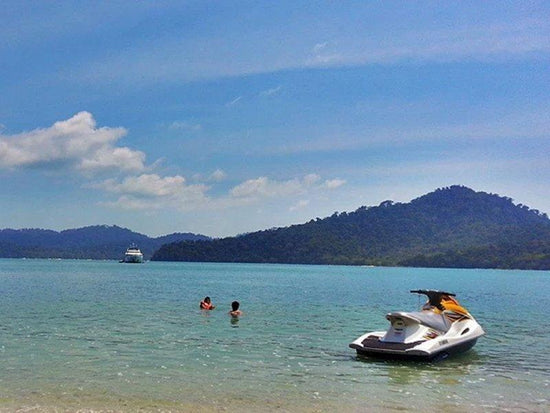 A jetski and swimmers on the Langkawi Island