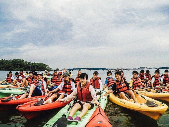 A large group of friends on a kayaking activity in Pulau Ketam