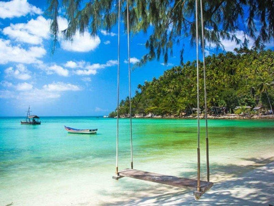 A wooden swing by the beach of Koh Phangan