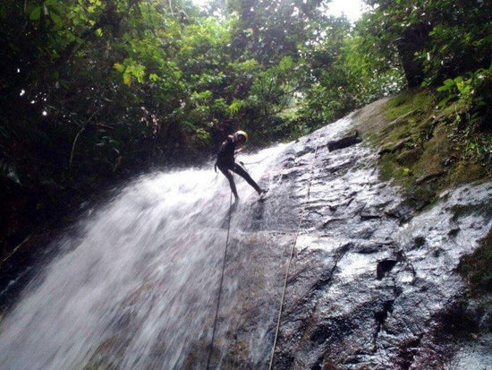 Abseiling down the waterfall in Gopeng