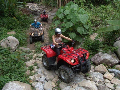 ATV riding near Song Preak River