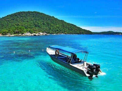 Boat on the ocean in Perhentian