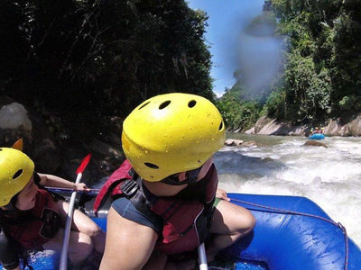 Closeup shot of participants on a white water rafting ride in Gopeng