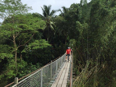 Cycling across the hanging bridge at the countryside of Kota Kinabalu