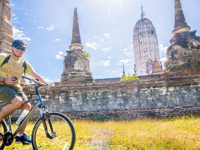 Cycling tourists at Ayutthaya historical city