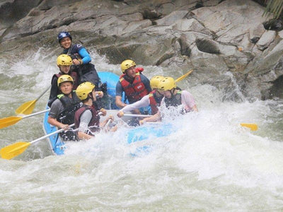 Group team building on white water rafting adventure activity
