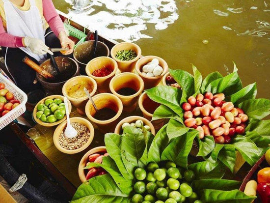 Ingredients for a traditional local cuisine on a boat at Damnoen Saduak Floating Market