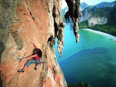 Lady rock climbing at Krabi Island