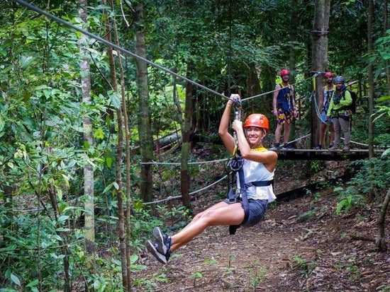 Lady zipping through the forest of Langkawi