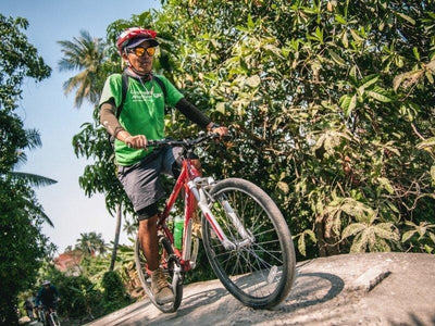 Local guide leading cycling tour at Bangkok countryside
