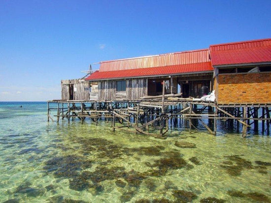 Mabul Island wooden house built on water near the shore