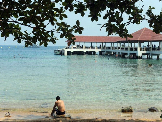 Man resting by the beach of Bidong Island