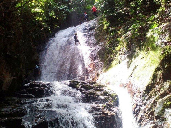 Man waterfall abseiling in Gopeng