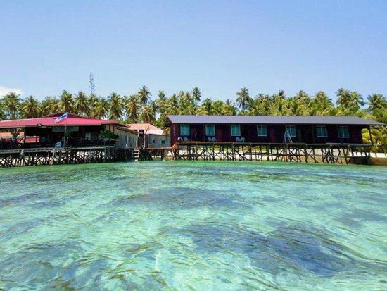 Resorts built by the shore at Mabul Island