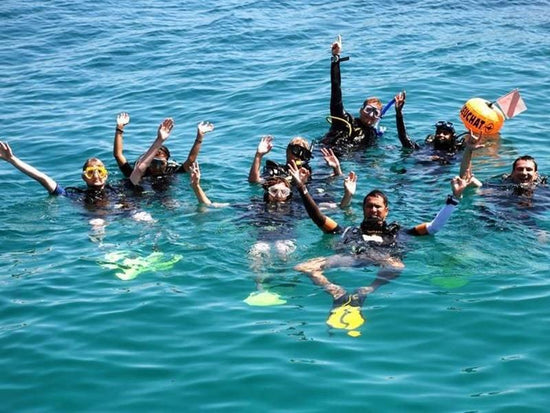 Scuba divers on the ocean at Pulau Tioman