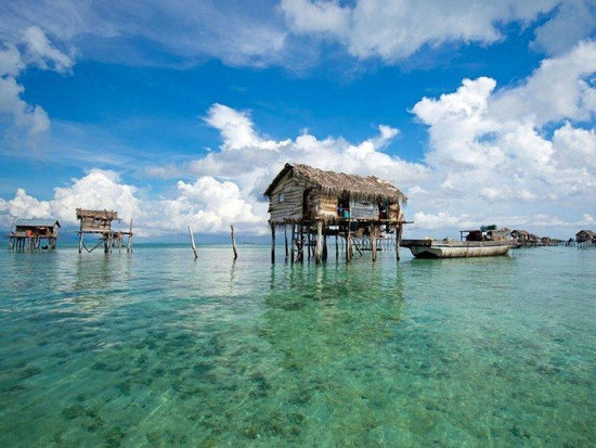 Sea gypsy houses built on waters in Mabul Island