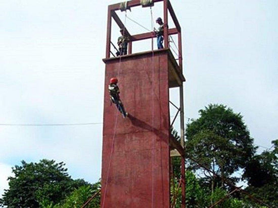 Tall wall with abseiling activity in Jeram Besu