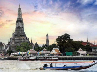 The Wat Arun temple beside Chao Phraya River