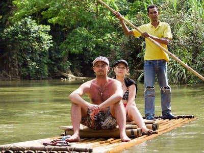 Tourist on a bamboo raft in Chiang Mai