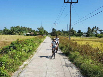 Tourists cycling in the roads of Krabi