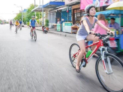 Tourists cycling past the streets of Bangkok