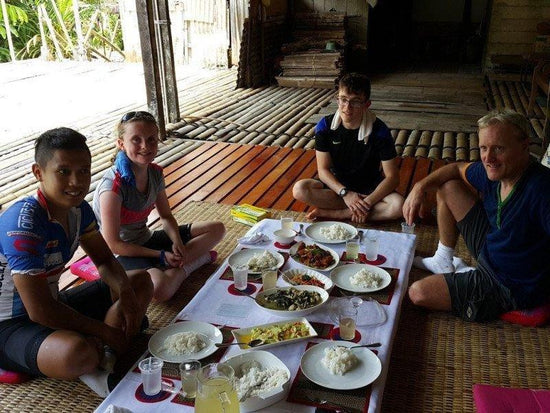 Tourists enjoying a local lunch in the longhouse in Kuching