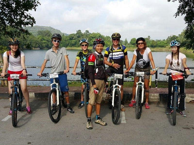 Tourists gearing up for the cycling tour at a riverside in Kuching