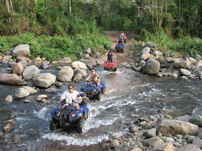 Tourists riding on ATV to Mok Fa Waterfall