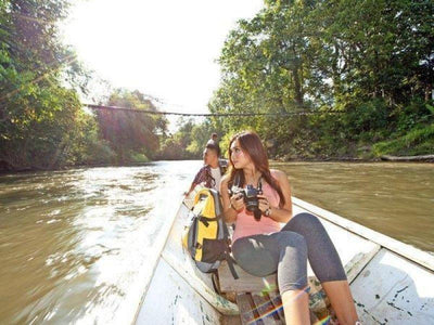 Tourists sightseeing on a longboat at Aiman Batang Ai