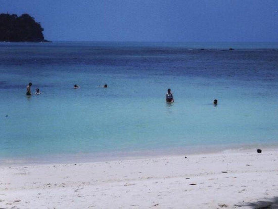 Visitors swimming near the shores at Monkey Beach