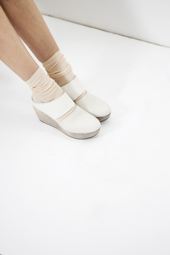 The Harlen Clog in three layers of white paired with a grey-washed clog wedge