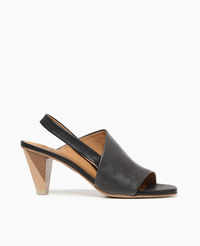 Coclico women's peep-toe slingback sandal in black veg tanned leather with a solid two-tone wood heel. Coclico shoes are sustainably made in Spain.