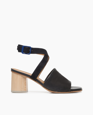 Coclico women's peep-toe ankle strap sandal in black veg tanned leather with a solid two-tone wooden heel. Coclico shoes are sustainably made in Spain.