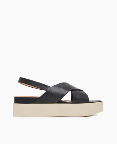 Coclico women's summer platform slingback sandal in black leather with a creamy white flatform sole. Coclico shoes are sustainably made in Spain.