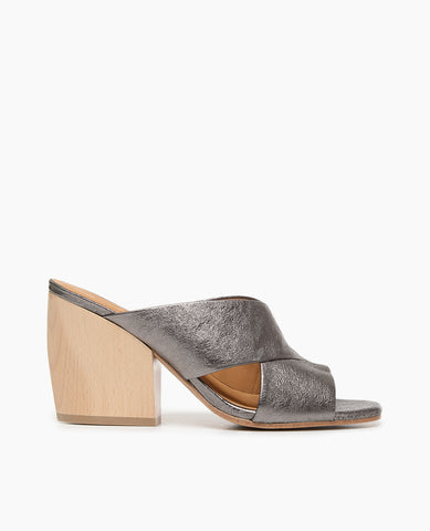 Coclico women's flattering slide featuring sweetheart lines and toe opening in a metallic gunmetal leather with a sculpted wood heel. Coclico shoes are sustainably made in Spain.