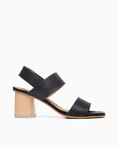 Coclico women's wooden block heel in a snake embossed leather. Coclico shoes are sustainably made in Spain.