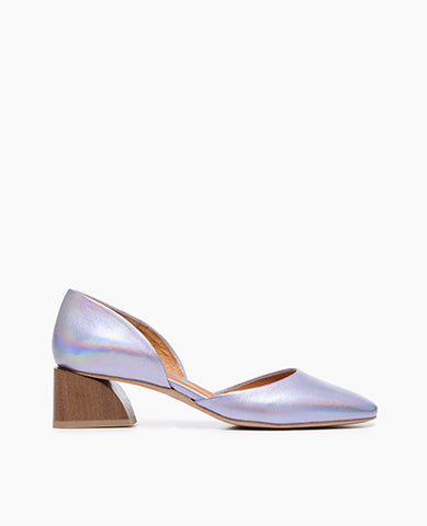 Coclico women's contemporary and playful low pump in iridescent lilac leather with a solid wood heel. Coclico shoes are sustainably made in Spain.