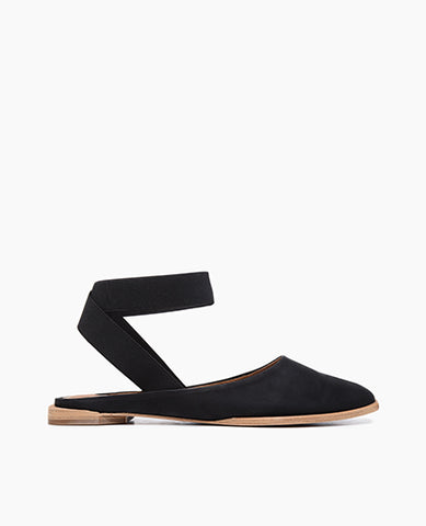 Coclico women's simple close toe flat with elastic ankle strap in black leather. Coclico shoes are sustainably made in Spain.
