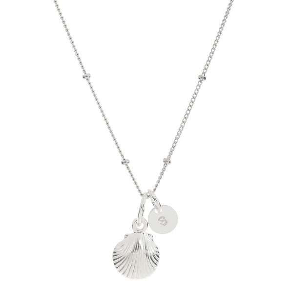 Mermaid shell and a personalised pendant hang alongside one another on a sterling silver ball chain necklace.  This necklace is called Mermaid Treasures as it is a treasured keepsake necklace that is designed to be worn by mothers and their children who love the sea.
