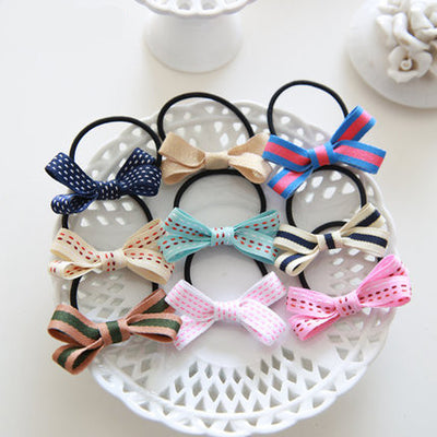 Rubber Bow Hairbands (9 pieces) HF00083
